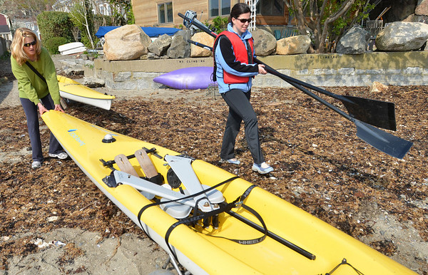 Marblehead: Ann Malloy of Marlbehead, left, and Elizebeth Rudcinski of Salem prepare to launch off Gas House Beach for a kayak trip. Mark Teiwes / Salem News
