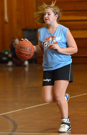 Peabody: Caley Hughes, 13, dribbles the ball up the court.   photo by Mark Teiwes / Salem News