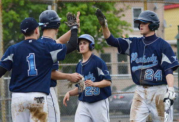 Beverly: Peabody's Bobby Losanno (23) and Genaro Ciulla get high fives after scoring runs late in the game against Bevelry.  photo by Mark Teiwes / Salem News