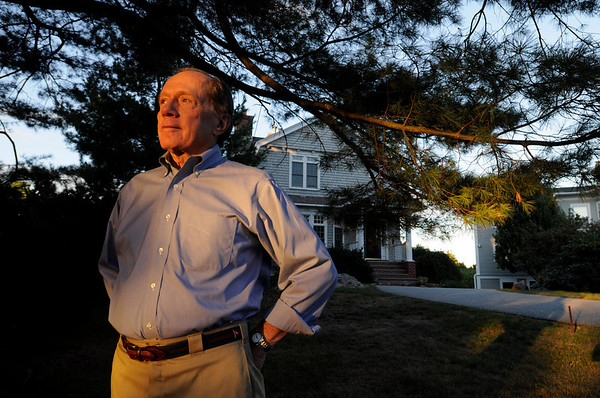 Marblehead: Wayne Johnson stands in front of his house.  After a 15 year legal battle, the Land Court has agreed with Johnson's neighbors, the Sheys, that his house doesn't have enough frontage to be a legal lot and therefore his house, which blocks their view, must come down.   photo by Mark Teiwes / Salem News