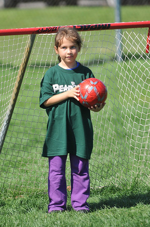 A Peabody Youth Soccer goalie smiles after making a save.