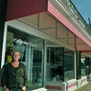 Danvers: Owner Kelly Delaney stands outside Cakes for Occasions in Danvers Square. photo by Mark Teiwes / Salem News