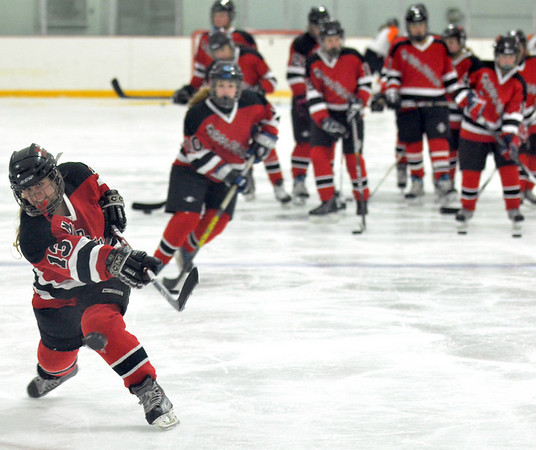 Stoneham: Marblehead's Ally Healy releases a slap shot during a drill before a game.  photo by Mark Teiwes  / Salem News