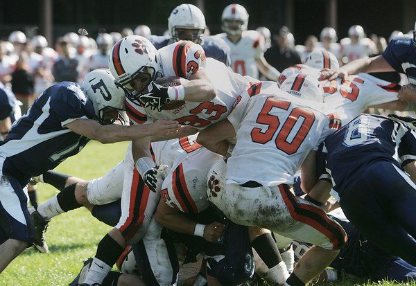 Peabody: Beverly's Brendan Flaherty dives for some yards against Peabody. photo by Mark Teiwes / Salem News