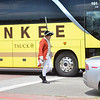 Salem: Dave Parker of West Newbury plays a British soldier patrolling along Derby street as a tourist bus drives by.   photo by Mark Teiwes/ Salem News