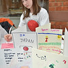 Salem: Zoe Poussard-Barham, 11, works on cards to send along with donations from a clothing drive for Japan.  photo by Mark Teiwes / Salem News