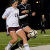 Lynn: Bishop Fenwick's Rose Fantozzi, right, challenges Belmont's Alexandra Cellucci in Division 2 north semifinals.  photo by Mark Teiwes / Salem News