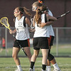 Ipswich: Ipswich's Nyra Constant, left, Mikhala Reedy, Lauren Piotroswki celebrate Reedy's goal.  photo by Mark Teiwes / Salem News
