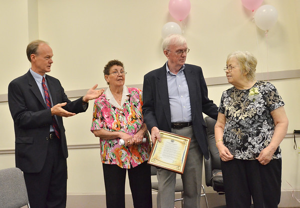 Danvers: Pat Toomey, right, is honored for her service to the town of Danvers.  Pictured from left, Wayne Marquis, town manager, Andrea S. Daley, and John and Pat Toomey. photo by Mark Teiwes /  Salem News