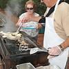 Danvers: Ross and Diane Ciciewsky cook pierogi for the Polish Club picnic.  photo by Mark Teiwes / Salem News