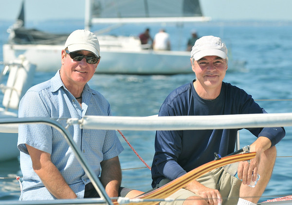 Marblehead:  Fred DeNapoli of Marblehead, left, owner of the Allegro Semplicita raced with the help of tactition Nick Burke, right, Marblehead High School sailing coach.  The Allegro was in first place in the second line after two days of racing at the PHRF New England Championship.  photo by Mark Teiwes / Salem News