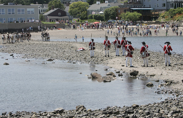 Marblehead:  A British regiment retreats to Gerry Island as Glover's Regiment advances.  Actors recreate 1775 military encampment and mock battles in Marblehead. photo by Mark Teiwes / Salem News