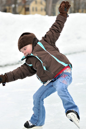 Salem:  4-year-old Julianna Kimball of Hamilton skates for the first time at the Salem Common. photo by Mark Teiwes / Salem News