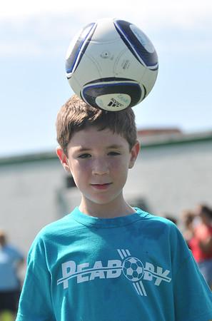 Thomas Lanes, 6, heads the ball.