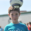 Thomas Lanes, 6, heads the ball.