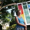 Wenham:  Artist Susan Quateman hung a print of silk scarves she made outside her home. Her work will be featured in the Art Grows Here exhibit.  photo by Mark Teiwes