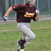 Beverly: Danvers National little league player Zach Sasso runs for a base hit.  photo by Mark Teiwes  / Salem News