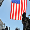 Swampscott: Massachusetts State Police Pipes and Drums group walk below a flag hoisted over Humphrey Street for the Veterans Appreciation Day parade.  photo by Mark Teiwes / Salem News