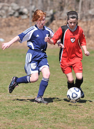 Middleton:  Middleton's Rachel Piraino, right, dribbles challenged by Hamilton-Wenham's Eliza Meahl.  photo by Mark Teiwes / Salem News
