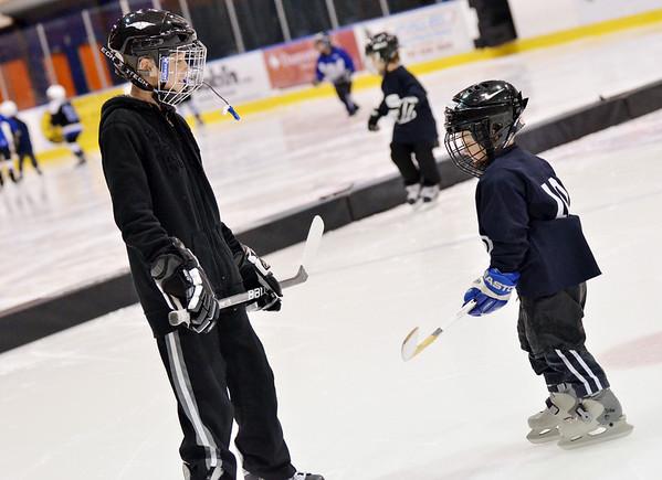 Salem: Devin Sobezenski, 11, and his brother Riley, 3, practice together with Salem Swampscott Blades hockey at Salem State University's Rockett Arena   photo by Mark Teiwes / Salem News