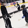 Salem: Devin Sobezenski, 11, and his brother Riley, 3, practice together with Salem Swampscott Blades hockey at Salem State University's Rockett Arena   photo by Mark Teiwes / Salem News