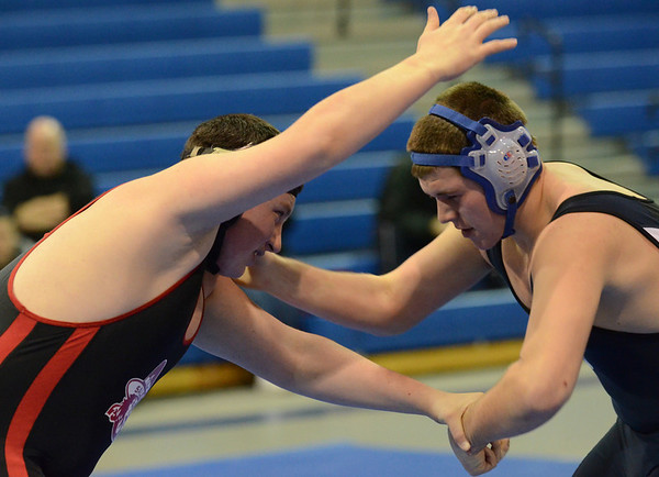 Peabody: Salem wrestler Pat Hagen, left, battles for position with Peabody's Frank Lowrey at the 215 pound division.  photo by Mark Teiwes  / Salem News