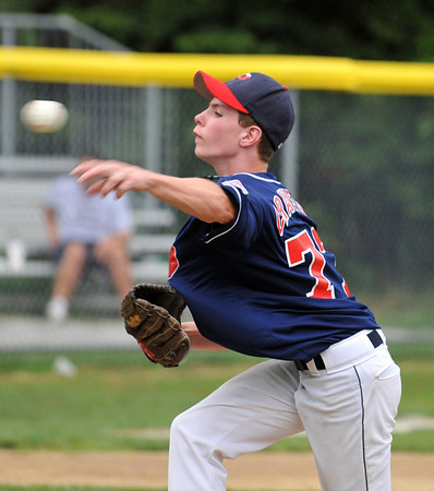 Woburn: Peabody West starting pitcher Zach Crawford throws a strike starting off the first inning with two strike outs and no hits.  photo by Mark Teiwes / Salem News