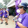 Beverly: Pam Morose blows a bubble prior to going up to bat and hitting a double for Alumni.  She has twin sons that graduated from St. John the Evangelist School.  photo by Mark Teiwes / Salem News