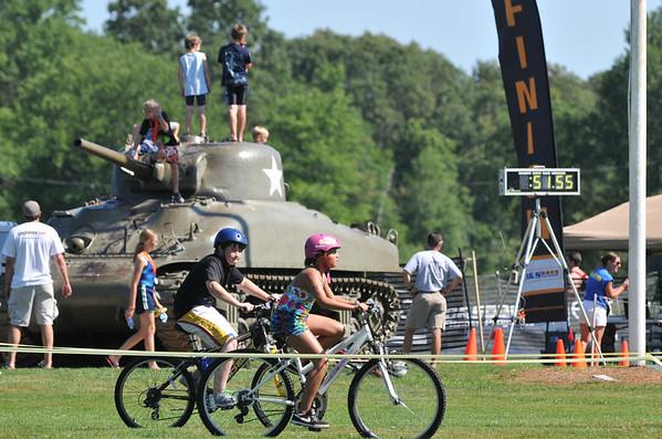 Hamilton: Two racers bike through Patton Park during the TriROK Foundation's kids's triathlon.   photo by Mark Teiwes / Salem News