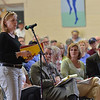 Wenham: Deb Evans questions the town finance and advisory committee about the budget for the school district at the Wenham town meeting. Mark Teiwes / Salem News