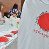 Salem:  The Poussard family created Kids 4 Japan, collecting clothing and donations.  The children are selling a teeshirt they designed with proceeds going to the Japanese Red Cross.  photo by Mark Teiwes / Salem News