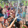 Salem: Saltonstall School 1st and 2nd graders cool off during recess.  The school's last day is July 29th. photo by Mark Teiwes / Salem News