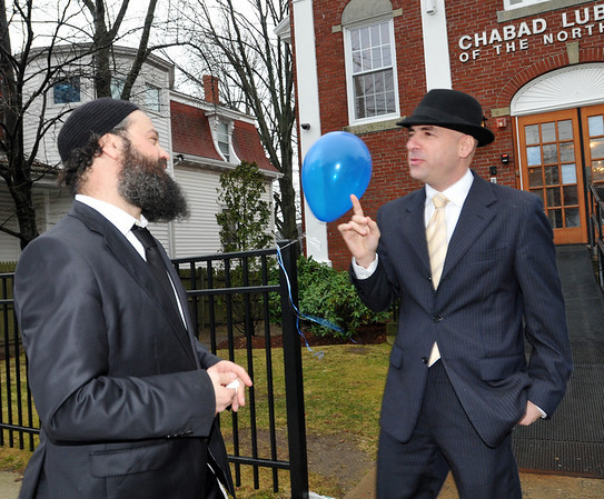 Swampscott: Rabbi Yossi Lipsker, left, the director and founder of Chabad of the North Shore speaks with the new Israeli Consul General, Shai Bazak.  photo by Mark Teiwes / Salem News