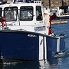 Danvers: Santa arrives along the Porter River in the Danvers harbormaster's boat.  photo by Mark Teiwes / Salem News