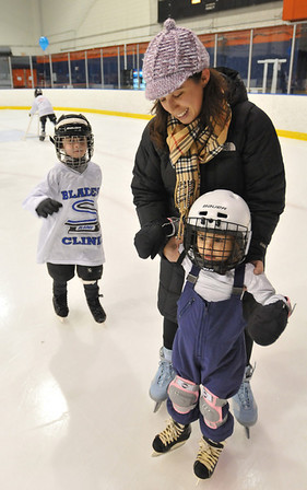 Salem: Joanna Ganci of Beverly teaches her 4-year-old daughter Elliot Rose Lund to skate followed by her son Emerson Lund, 6.   photo by Mark Teiwes / Salem News