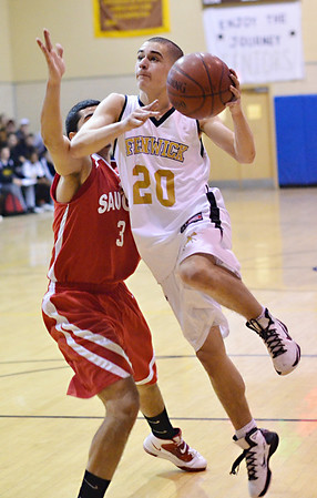 Peabody: Bishop Fenwick captain Alex Morsey springs past Saugus defender Omar Benabicha.  photo by Mark Teiwes  / Salem News