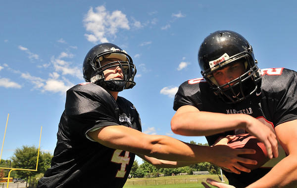 Marblehead: Marblehead High School tootball team starting running back Will Quigley, right, recieves a hand off from quarterback Dan Colbert.  photo by Mark Teiwes / Salem News