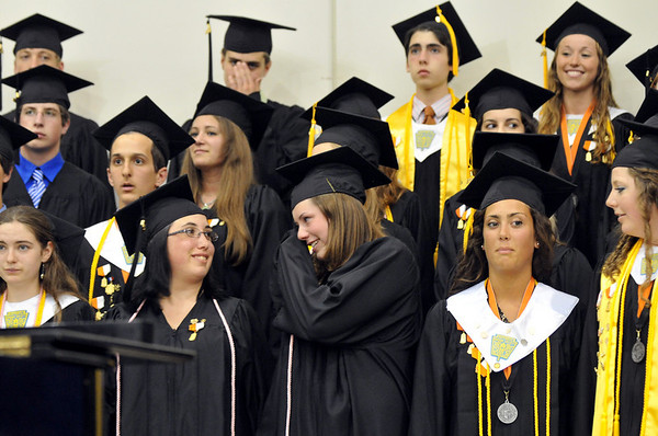 """Ipswich: Casey Lubell, center,  wipes a from her eye after singing """"For Good"""" with the Ipswich High School concert choir during graduation.  photo by Mark Teiwes / Salem News"""