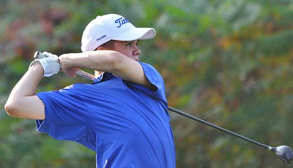 Peabody: Danvers High School's number two golfer Dan McKenna follows through after teeing off.    photo by Mark Teiwes / Salem News