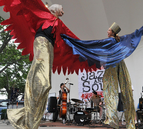 Salem: Stilt walkers Mark Alexander, left, and Maya Apfelbaum of the Moral Beasts and Deities, and Boston Circus Guild dance on stage as Emperor Norton's Stationary Marching Band performs at the Salem Jazz and Soul Festival.    photo by Mark Teiwes / Salem News