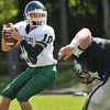 Hamilton: Pentucket quaterback Ryan Kuchar scans the field for a pass.  photo by Mark Teiwes  / Salem News