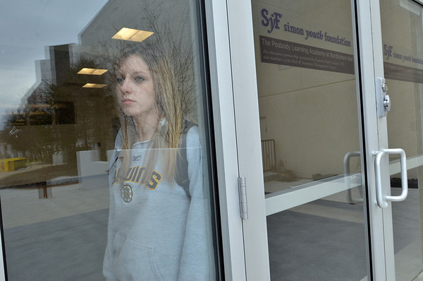 Peabody: Lyndsay Konovalchik waits for her ride after a day at Peabody Learning Academy.  photo by Mark Teiwes / Salem News