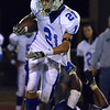 Peabody:  Danvers captain Alex Valles runs past a Peabody defender.  photo by Mark Teiwes