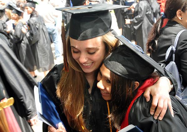 Salem: Margaret Hall, left,  shares a hug with Sara Morin after Salem State College's graduation. Photo by Mark Teiwes / Salem News