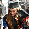 Salem: Margaret Hall, left,  shares a hug with Sara Morin after Salem State College's graduation. Photo by Mark Teiwes / Salem News