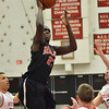 Salem: Marblehead's Malik Abu puts up a jump-shot surrounded by Salem defense. photo by Mark Teiwes / Salem News