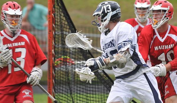 Danvers: St John's Prep senior lacrosse player Bobby Gallahue attacks the goal.  Photo by Mark Teiwes / Salem News