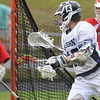 Danvers: St John's Prep senior lacrosse player Bobby Gallahue attacks the goal.  Photo by Mark Teiwes / Salem News