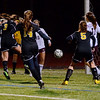 Lynn: Bishop Fenwick's #3 Sara Previte, left, scores to tie Belmont in Division 2 north semifinals forcing overtime.  Belmont went on win 2-1.  photo by Mark Teiwes / Salem News