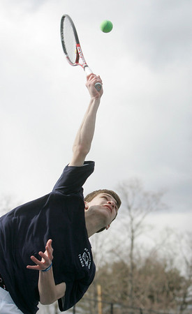 Danvers: St. John's Prep tennis player Chris Toner, sophmore, serves.  photo by Mark Teiwes / Salem News